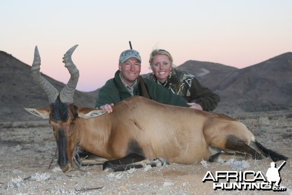 My wife and I with a Red Hartebeest taken in Southern Namibia with Kum Kum