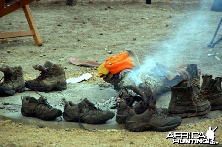 Hunting Shoes Drying Around Camp Fire
