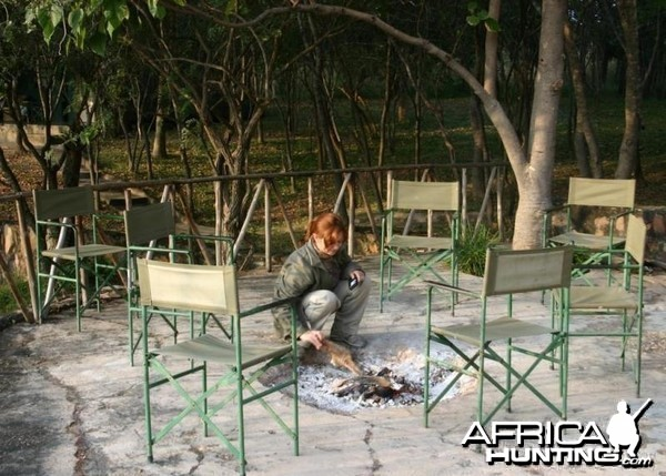 Stoking the Fire at Camp in Zimbabwe