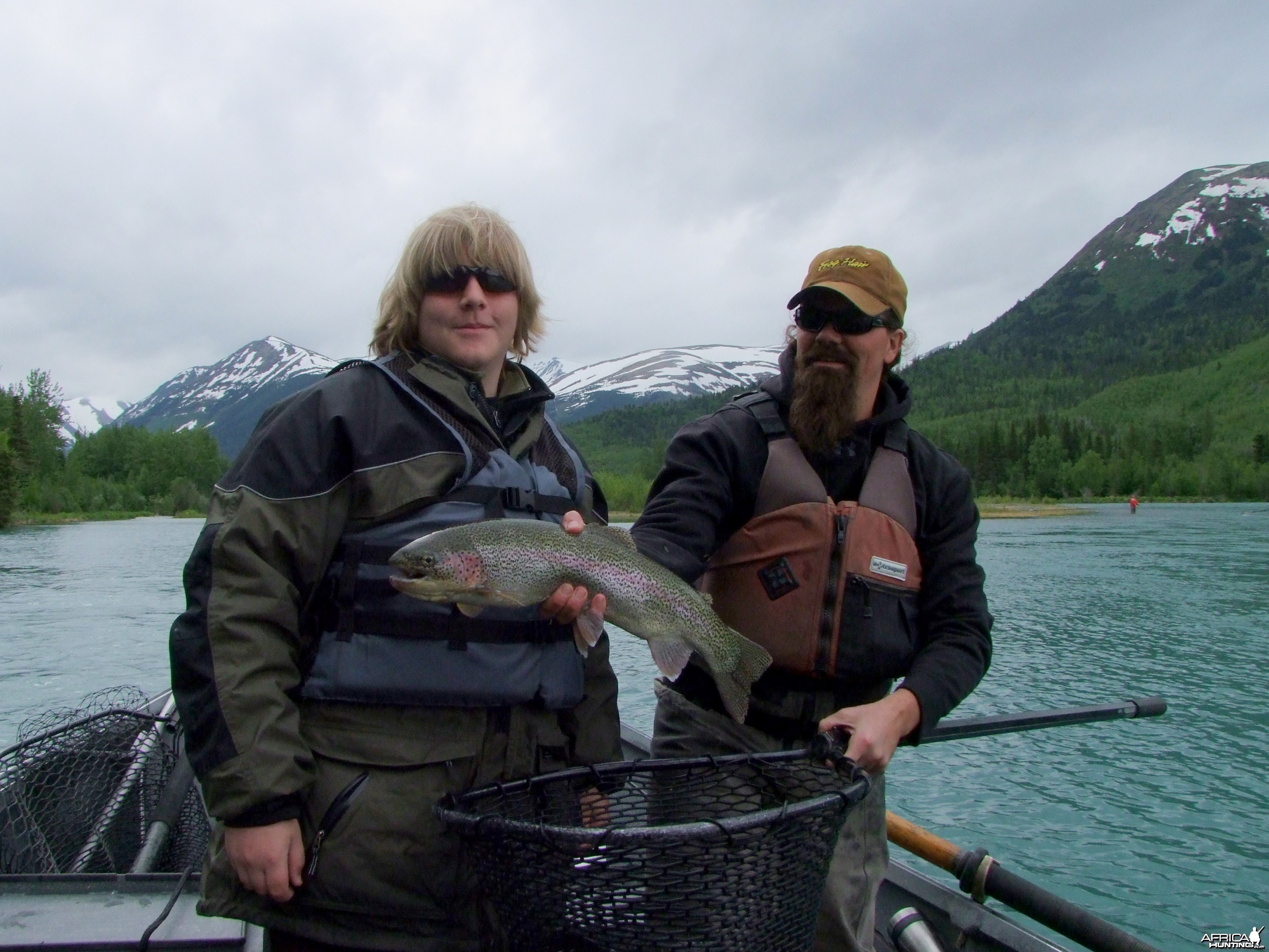 My son with the biggest rainbow of the day on the Kenai River