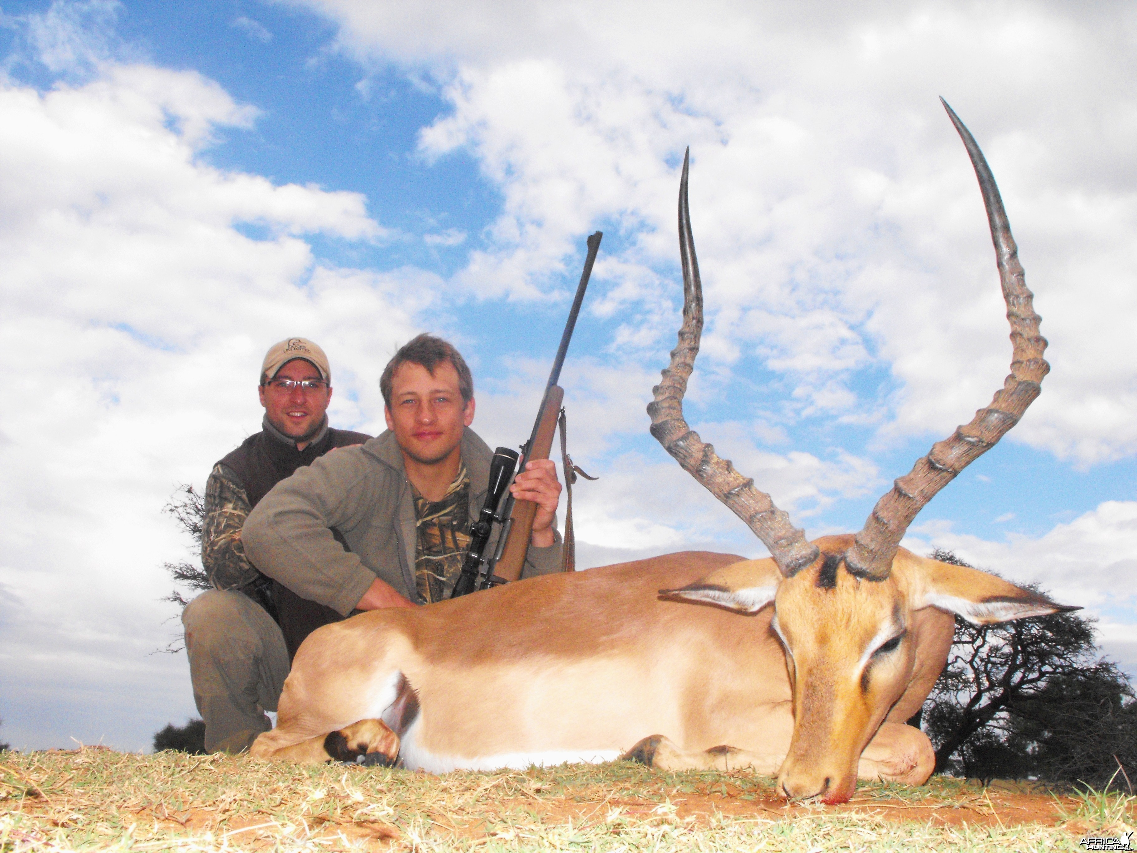 Two happy brothers with a last dandy, last day Impala ram
