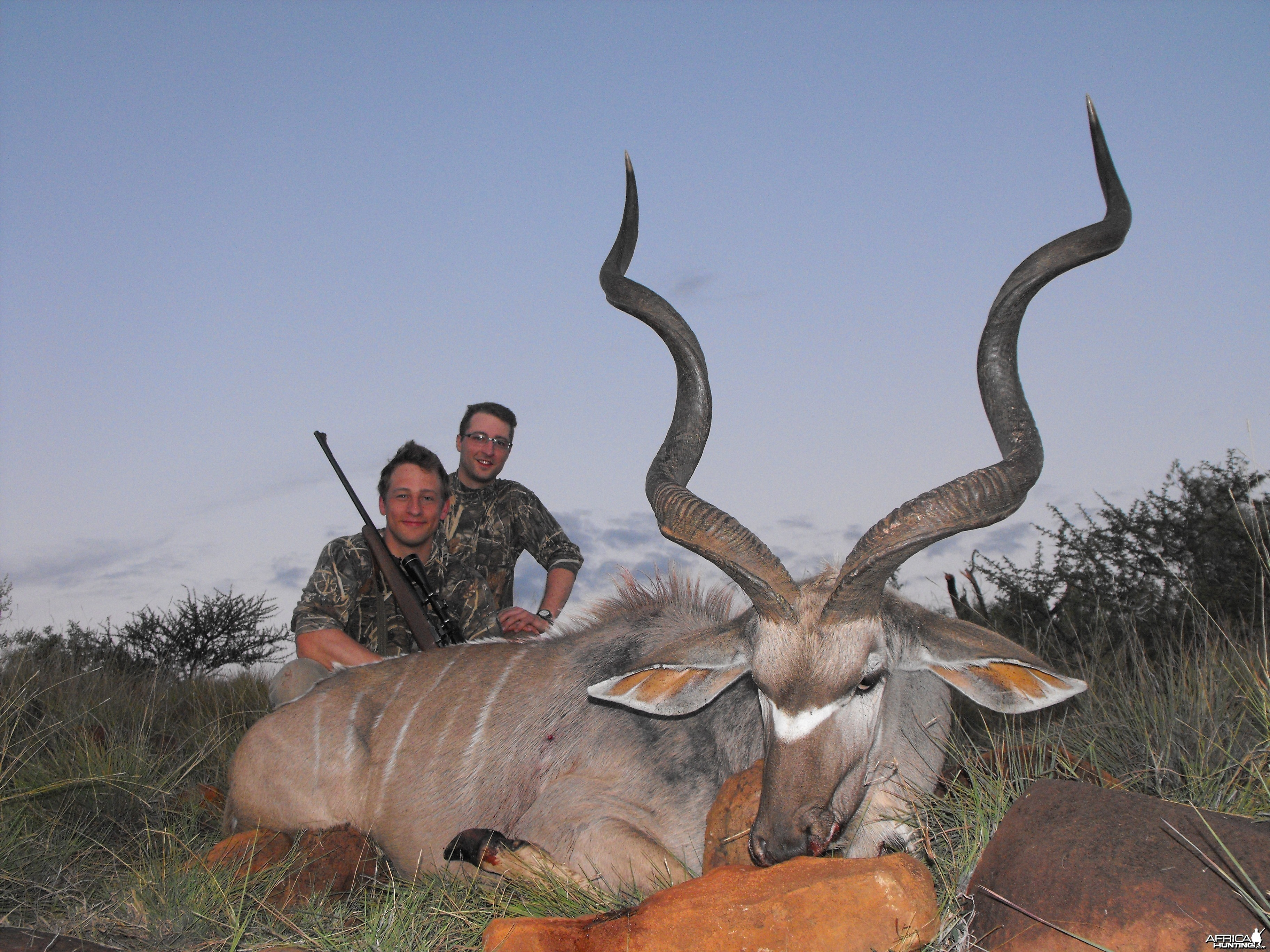 My little brother and I with his awesome Kudu bull