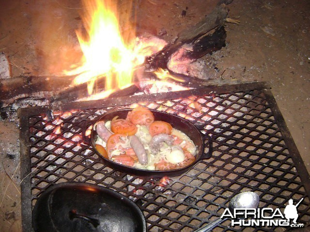 Campfire meal after the hunt
