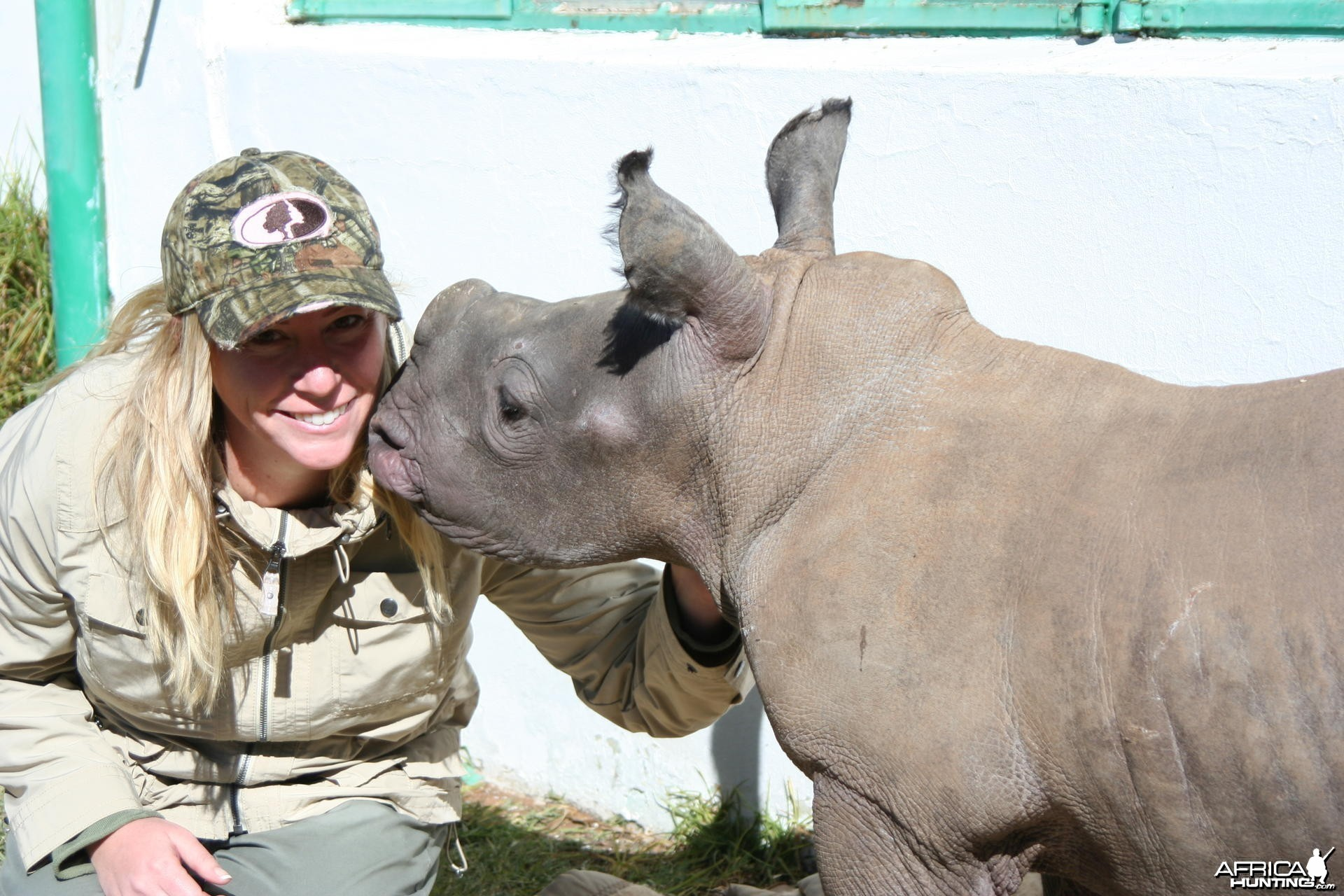Here is a picture of my wife and the baby rhino on the farm