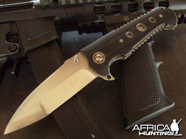 a tactical folding knife, with titanium and G10 frame