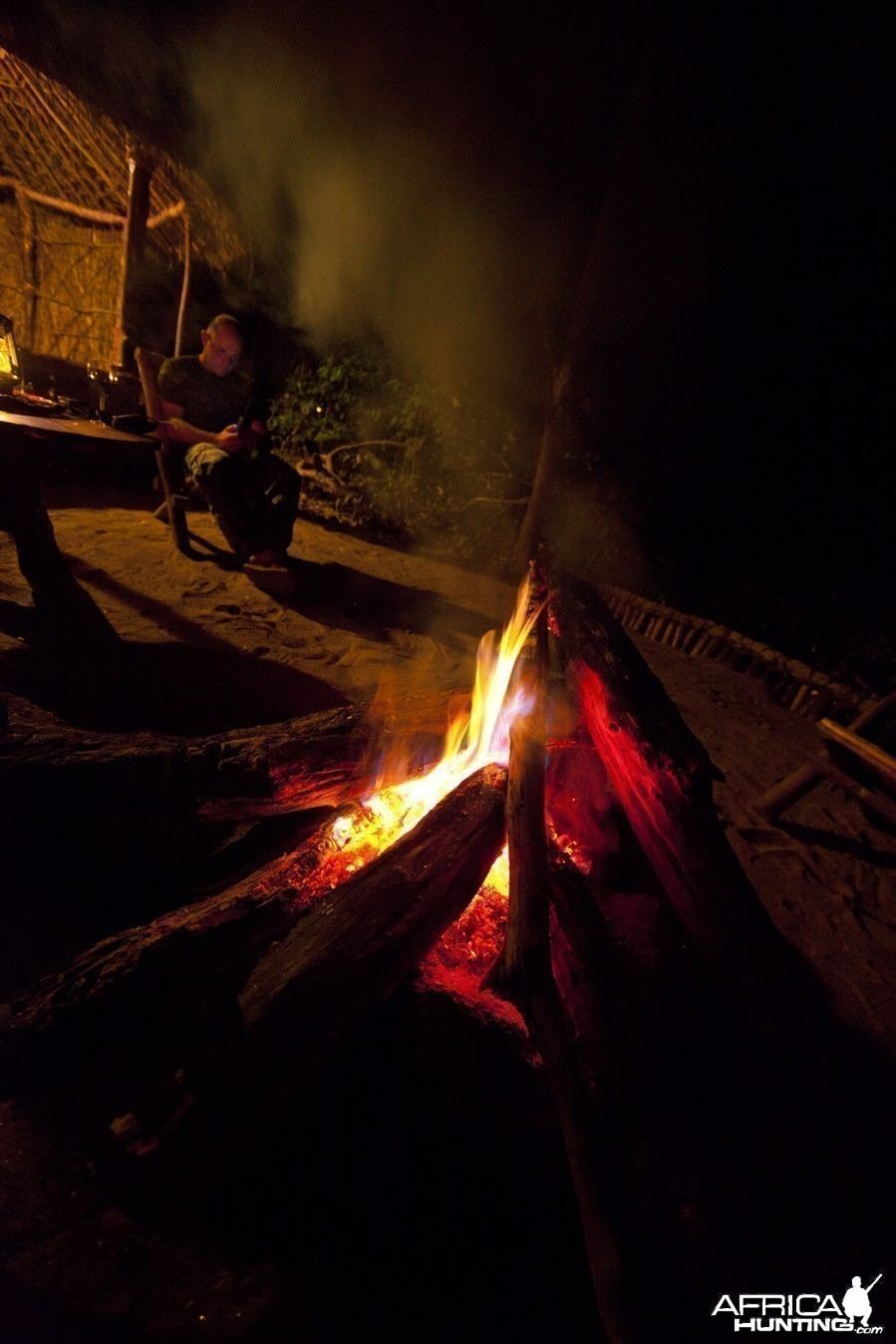 Man by campfire...