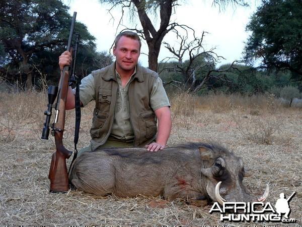 """12""""Warthog taken near Grootfontein, Namibia, by Charl Kemp"""