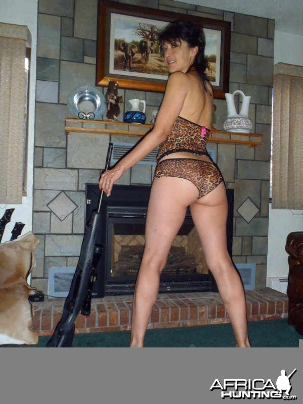 Comfy at the Fireplace with Rifle