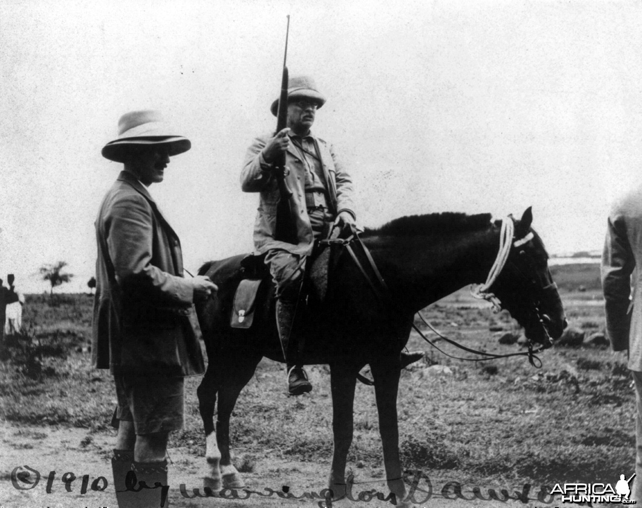 Theodore Roosevelt holding rifle on horseback in Africa, circa 1910