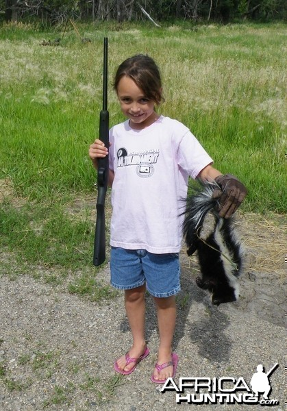 8 year old granddaughters first kill with her new .22, a skunk; PRICELESS