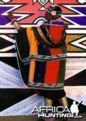 Ndebele Woman painting her Home