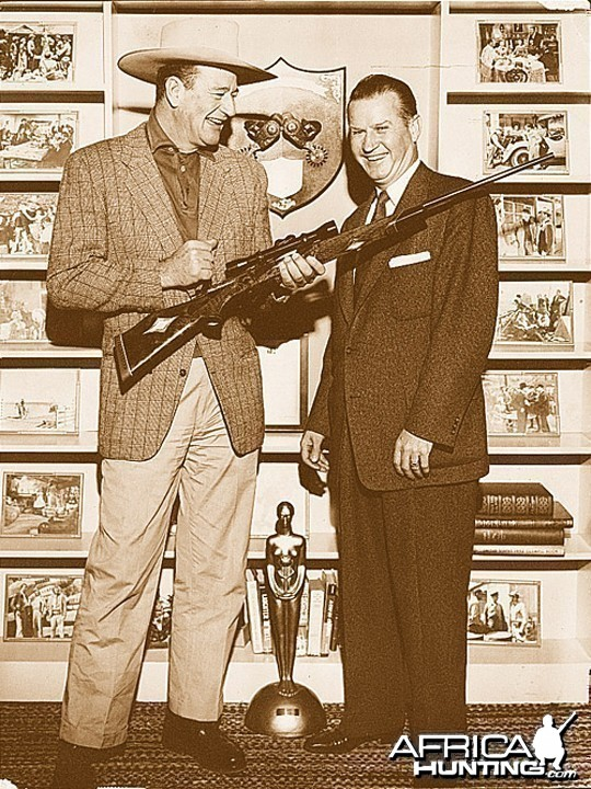 Roy Weatherby delivering John wayne his custom .300 WM