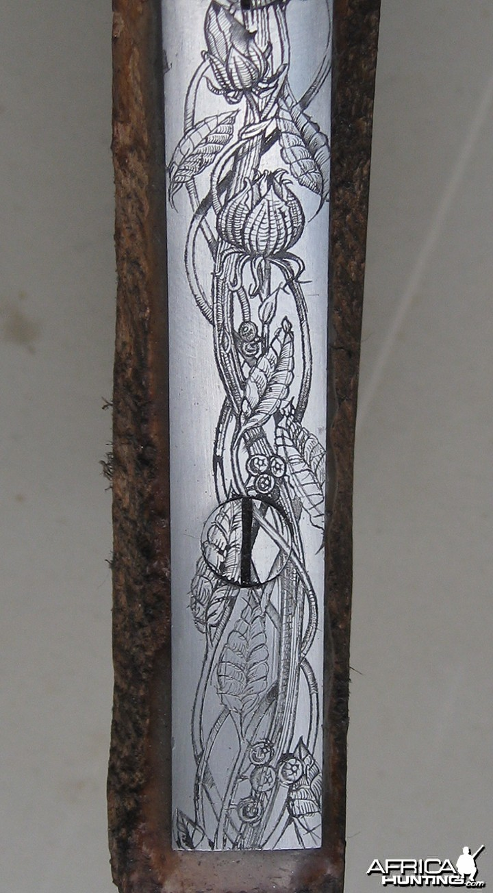 Engraved long trigger guard
