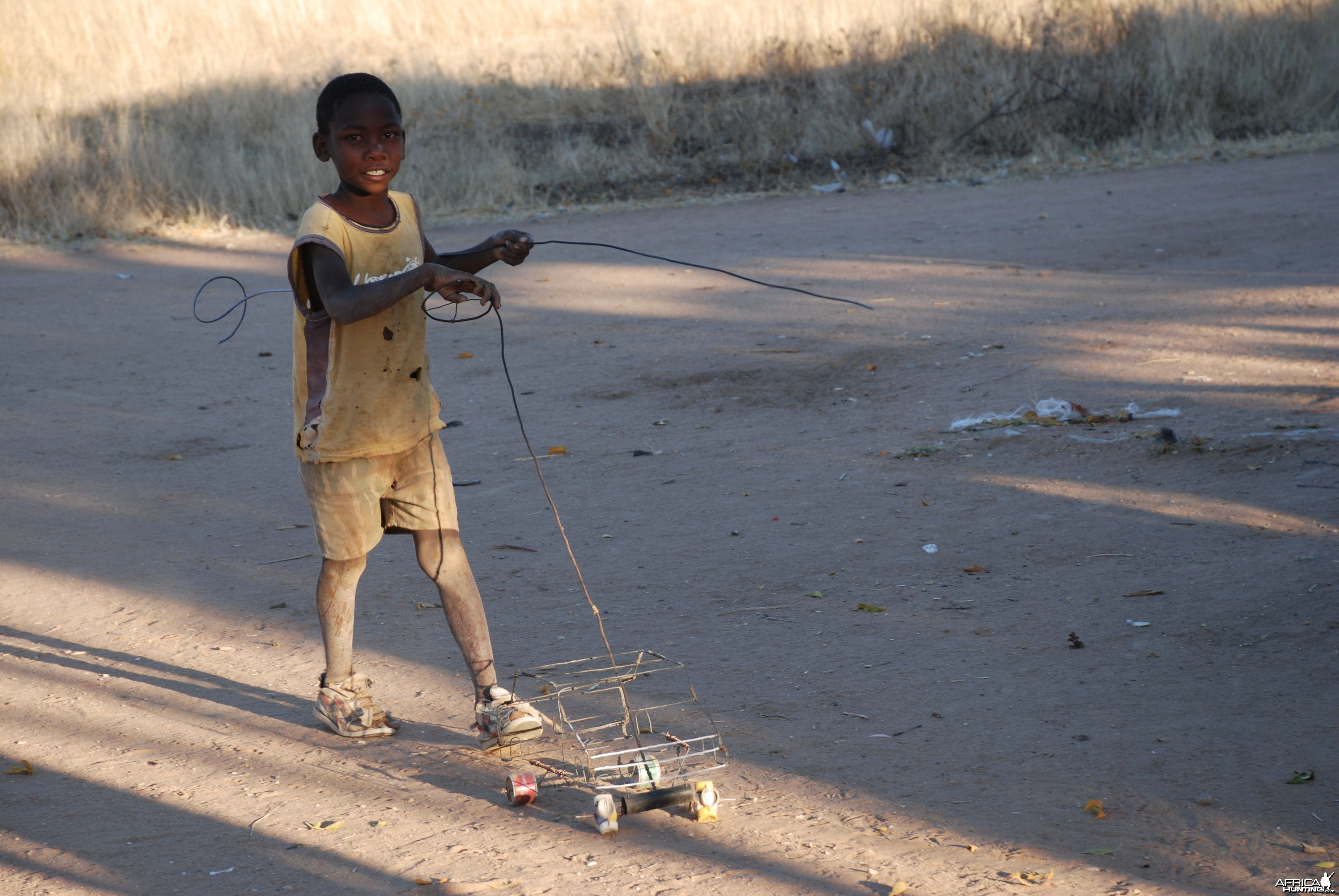 Little boy playing with his car, Namibia