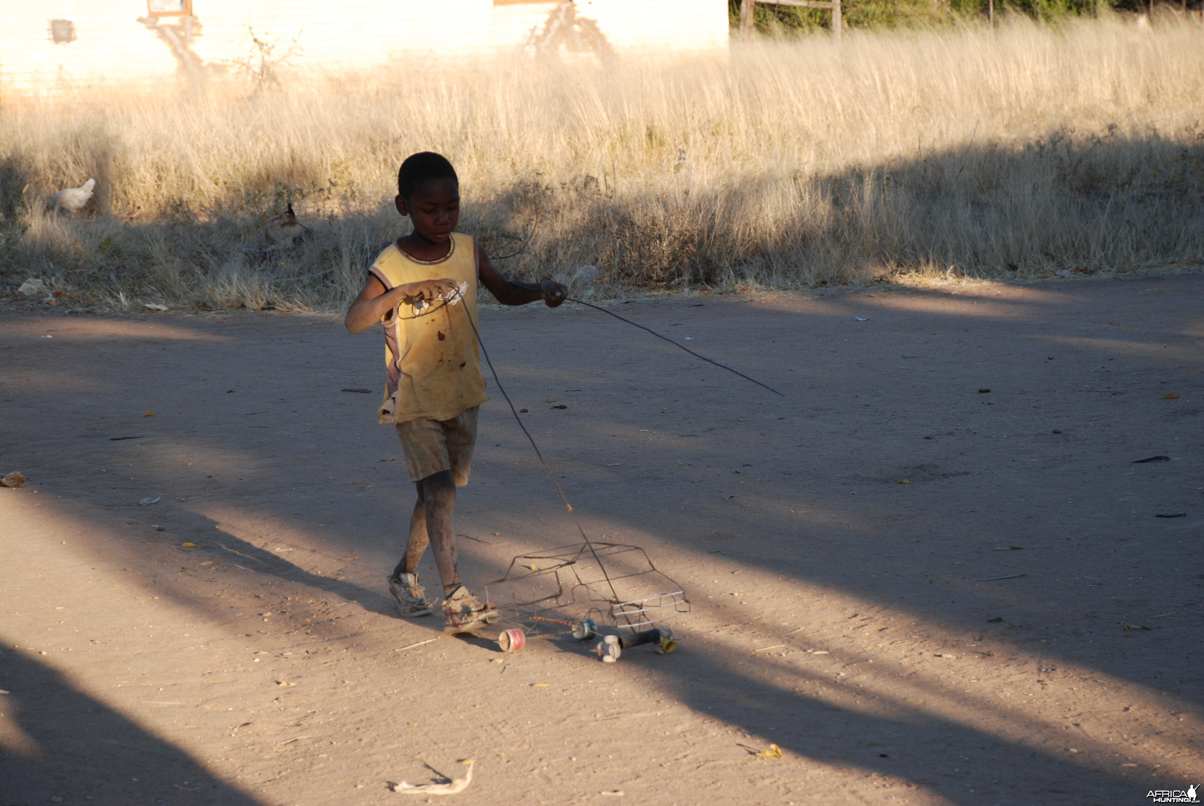 Boy playing with his car Namibia