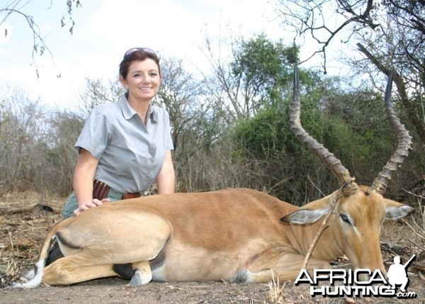 A very happy huntress with her first African kill