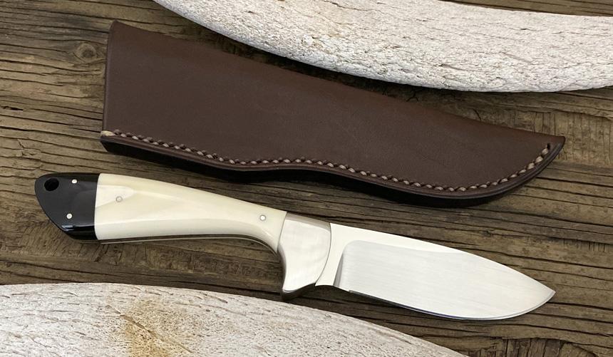 _0038_DAG 015 - Dagga 2020 - Warthog tusk.Buffalo horn - Back.jpg