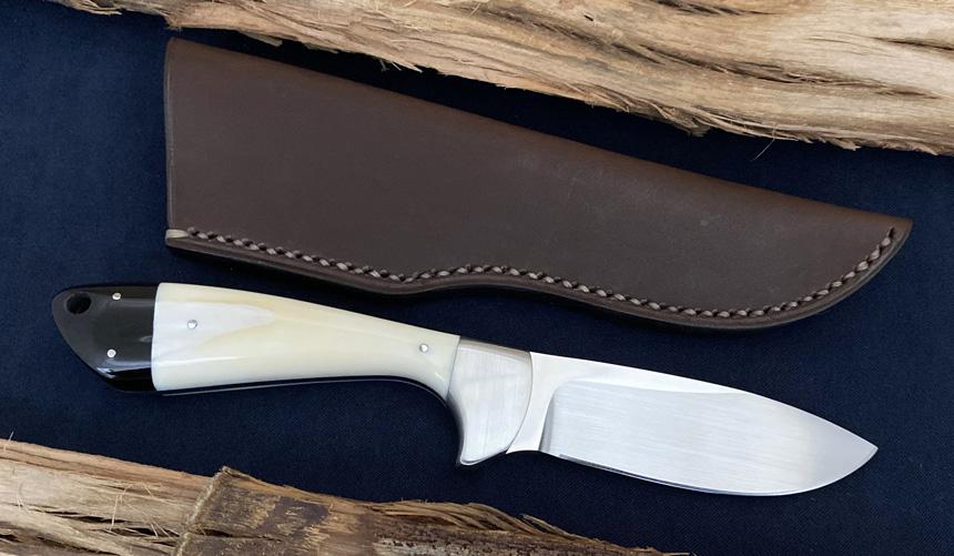 _0042_DAG 014 - Dagga 2020 - Warthog tusk.Buffalo horn - Back.jpg