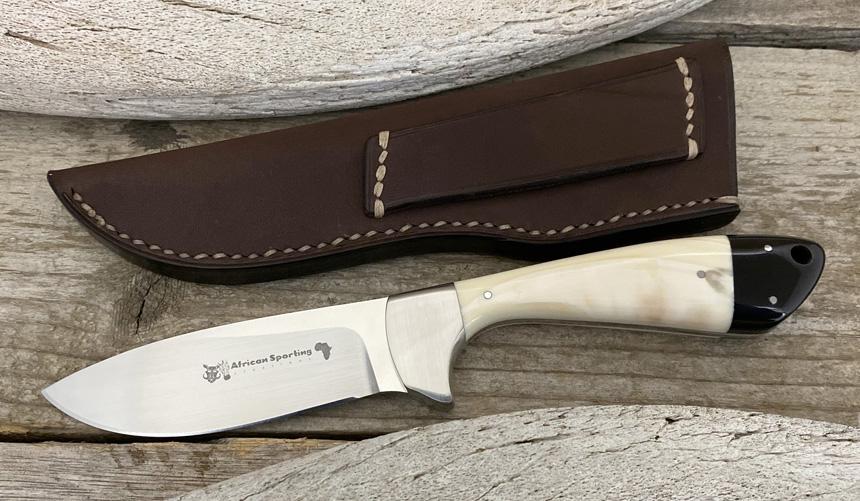 _0044_DAG 013 - Dagga 2020 - Warthog tusk.Buffalo horn - Front.jpg