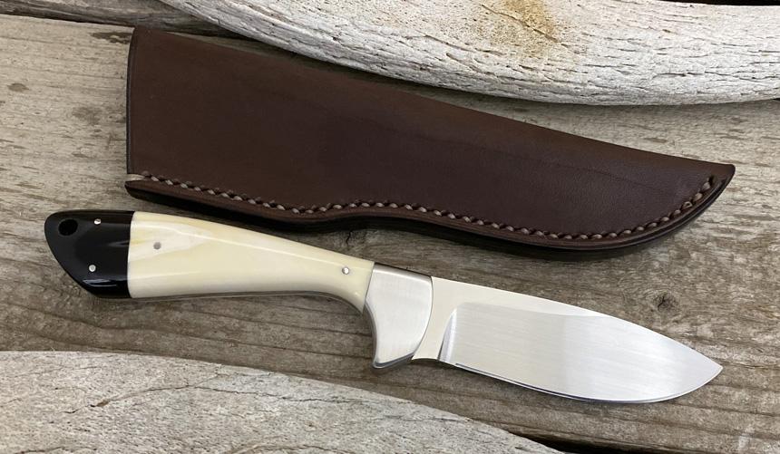 _0046_DAG 013 - Dagga 2020 - Warthog tusk.Buffalo horn - Back.jpg