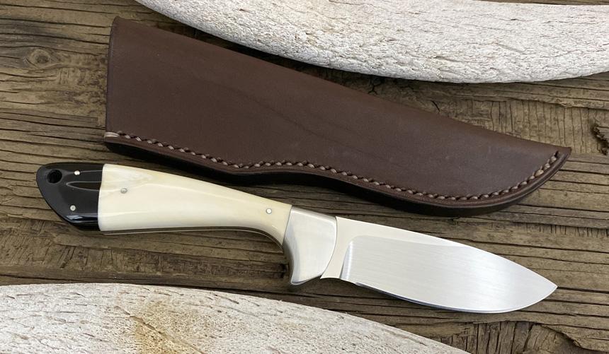 _0054_DAG 011 - Dagga 2020 - Warthog tusk.Buffalo horn - Back.jpg