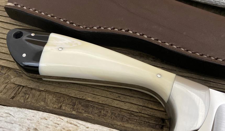 _0055_DAG 011 - Dagga 2020 - Warthog tusk.Buffalo horn - Back close up.jpg