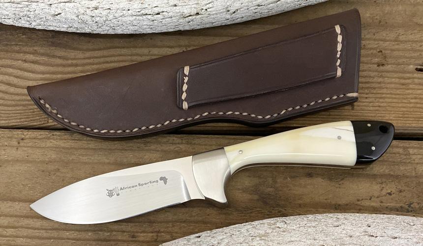 _0060_DAG 009 - Dagga 2020 - Warthog tusk.Buffalo horn - Front.jpg