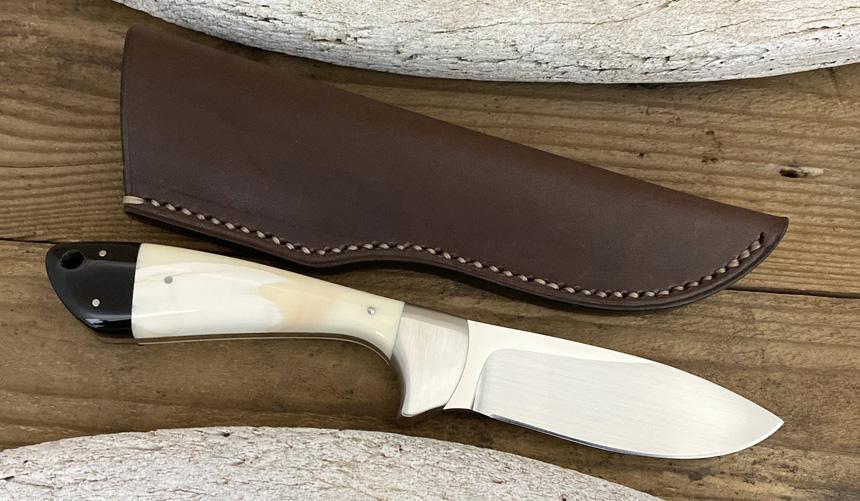 _0062_DAG 009 - Dagga 2020 - Warthog tusk.Buffalo horn - Back.jpg
