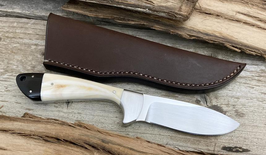 _0066_DAG 008 - Dagga 2020 - Warthog tusk.Buffalo horn - Back.jpg