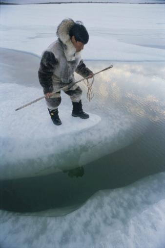 Baffin Island, Nunavut, Canada. An Inuit hunter waits for seals.jpg