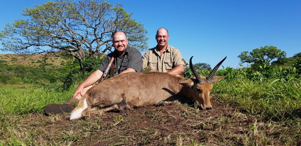 Boela Bekker and me with my first common reedbuck..jpg