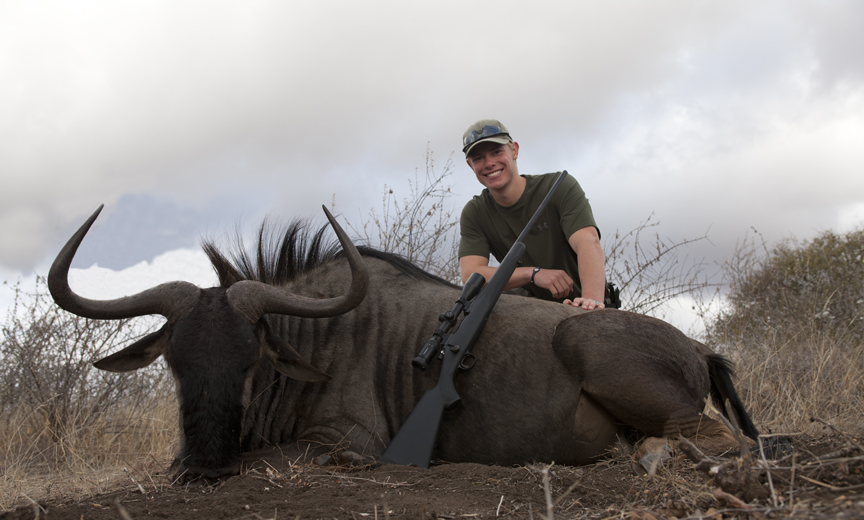 Dawson and wildebeest.jpg