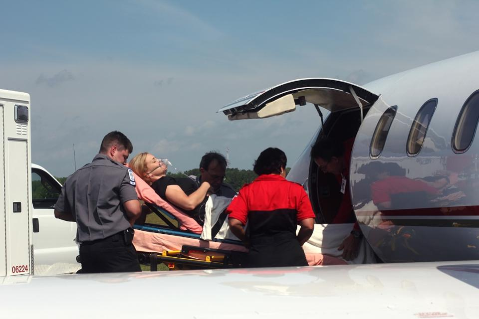 patient-entering-plane-with-ambulance-close-up.jpg
