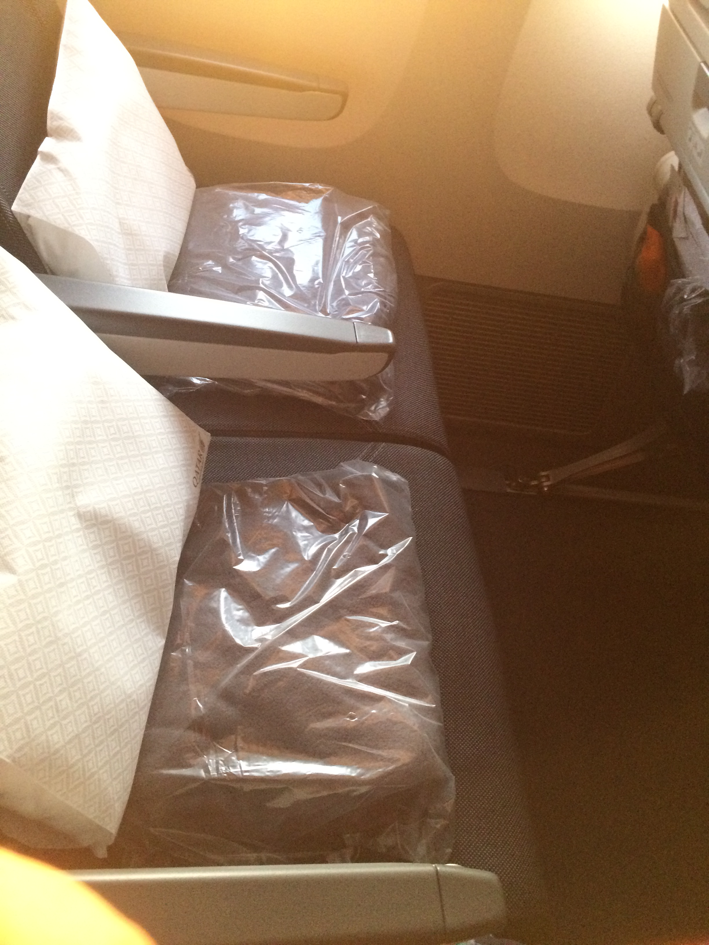 qatar airlines seats with amenities.JPG