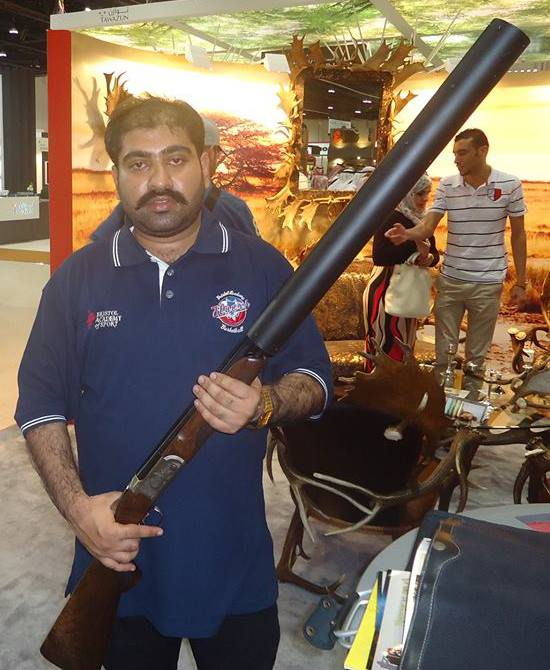 Shotgun with full size sound moderator (silencer) at the Abu Dhabi International Hunting and Equ.jpg