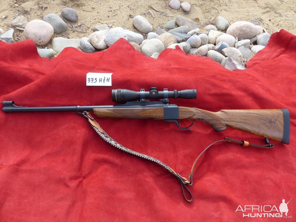 375 H&H Dakota Model 10 Rifle with Express sights, Leupold VX2