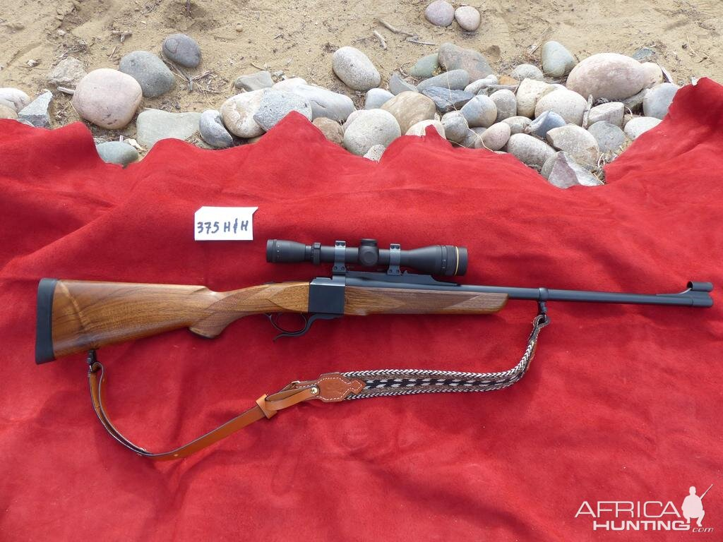 375 H&H Dakota Model 10 Rifle with Express sights, Leupold VX2 3x9x40 in Talley rings
